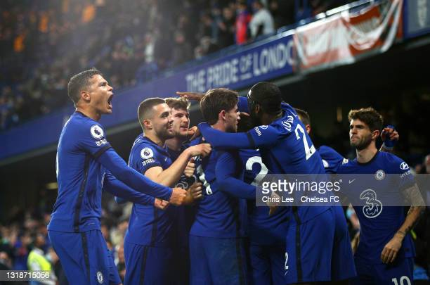 Players of Chelsea celebrate as Jorginho scores their sides second goal from the penalty spot during the Premier League match between Chelsea and...
