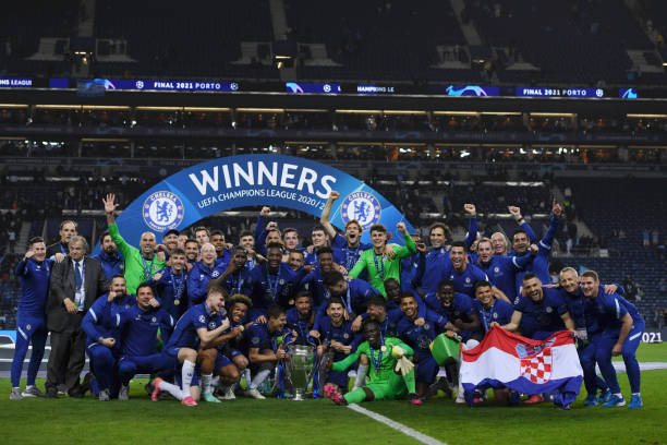 Players of Chelsea celebrate with the trophy at the end of the UEFA Champions League final match against Manchester City at Dragao Stadium on May 29,...