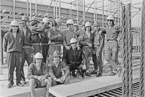 Players of Chelsea FC visit the new East Stand being built at Stamford Bridge, the Chelsea football ground in London, UK, March 1973.