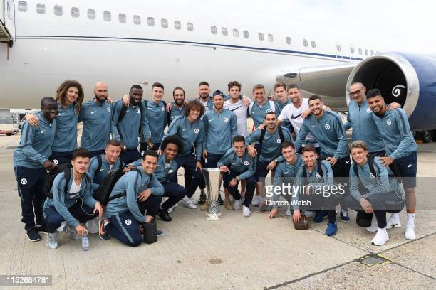 Players of Chelsea pose for a photo with their Europa League Trophy following their victory in the Europa League final on May 30 2019 in London...