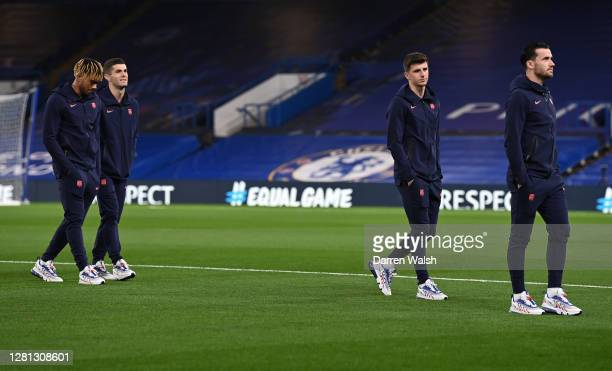 Players of Chelsea take part in a pitch inspection prior to the UEFA Champions League Group E stage match between Chelsea FC and FC Sevilla at...
