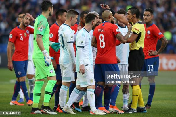 Players of Chile and Argentina argue with Referee Mario Diaz de Vivar after Gary Medel of Chile and Lionel Messi of Argentina were shown the red card...