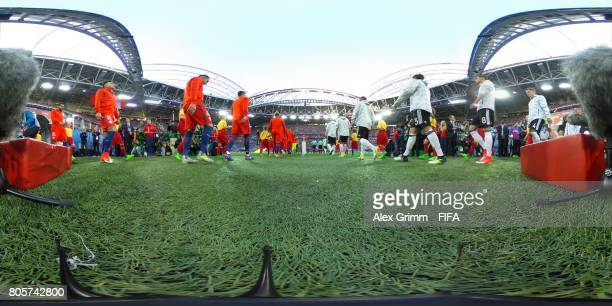 Players of Chile and Germany walk out onto the pitch ahead of the FIFA Confederations Cup Russia 2017 Final between Chile and Germany at Saint...