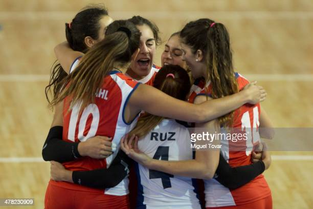 Players of Chile celebrate a point during a women's volleyball match between Chile and Brazil as part of day six of the X South American Games...