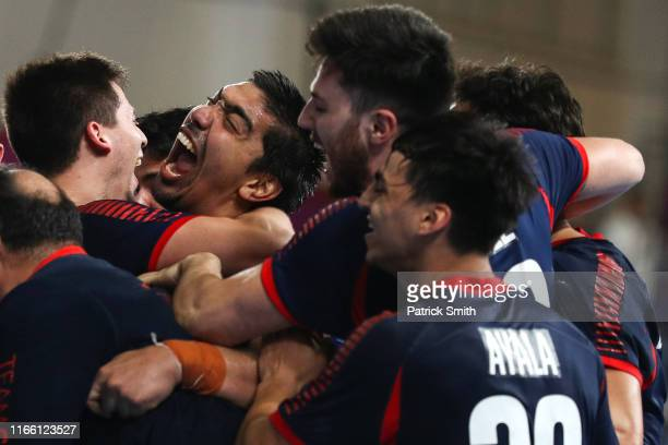 Players of Chile celebrate after defeating Brazil, 32-29, during the Men´s Handball Semifinal between Brazil and Chile on Day 9 of Lima 2019 Pan...