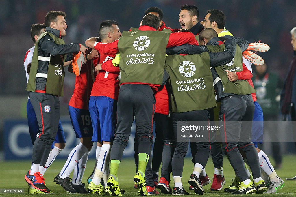 Players of Chile celebrate after the 2015 Copa America Chile Semi Final match between Chile and Peru at Nacional Stadium on June 29, 2015 in Santiago, Chile.