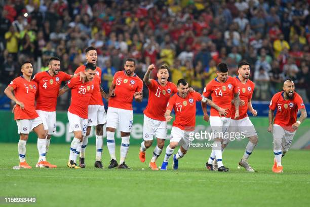 Players of Chile celebrate after winning during a penalty shootout after the Copa America Brazil 2019 quarterfinal match between Colombia and Chile...