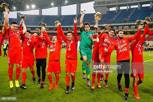 Players of Chile celebrate after winning the final match of 2017 Gree China Cup International Football Championship between Iceland and Chile at...