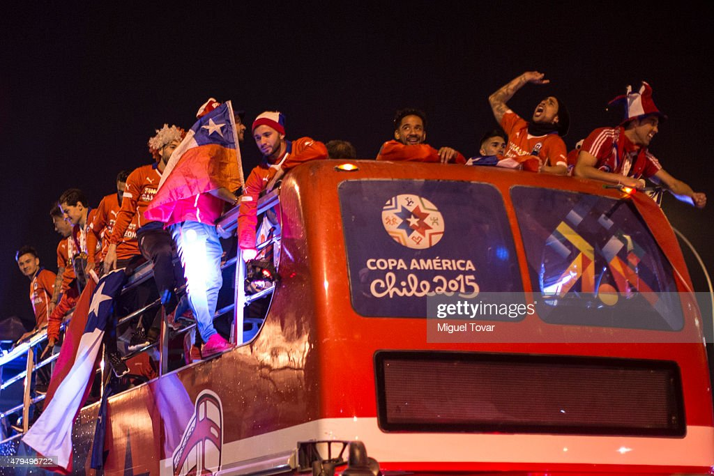 Players of Chile celebrate on the open top bus after winning the 2015 Copa America Chile Final match between Chile and Argentina at Nacional Stadium on July 04, 2015 in Santiago, Chile.