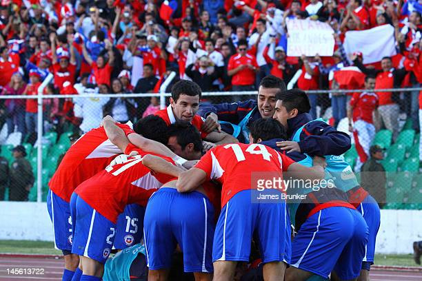 Players of Chile celebrate the first goal of their team during a match between Chile and Bolivia as part of the fifth round of the South American...