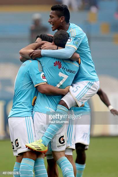 Players of Chile celebrate the third goal of the match scored by Irven Avila against Inti Gas during a match between Sporting Cristal and Inti Gas as...