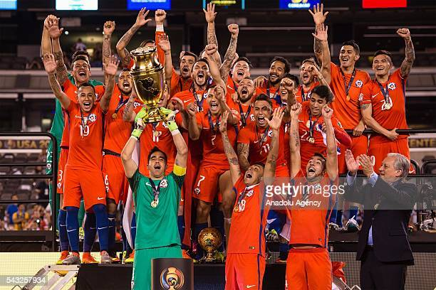 Players of Chile celebrate with the trophy after the championship match between Argentina and Chile at MetLife Stadium as part of Copa America...