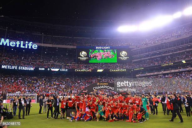 Players of Chile celebrate with the trophy after winning the championship match between Argentina and Chile at MetLife Stadium as part of Copa...