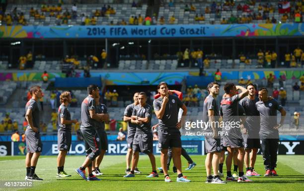 Players of Chile during a warm up prior to the 2014 FIFA World Cup Brazil Round of 16 match between Brazil and Chile at Estadio Mineirao on June 28...