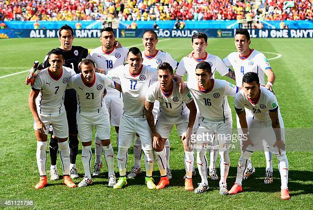 Players of Chile line up prior to the 2014 FIFA World Cup Brazil Group B match between Netherlands and Chile at Arena de Sao Paulo on June 23 2014 in...