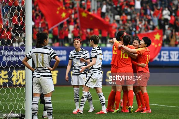 Players of China celebrate a goal by team mate Wang Shuang during the Tokyo Olympics Women's Football Asian Final Qualifier 2nd leg match between...