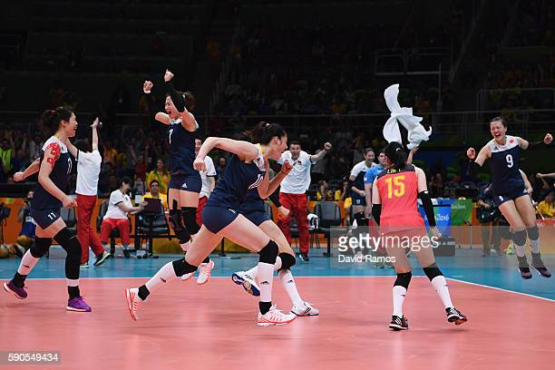 Players of China celebrate defeating Brazil during the Women's Quarterfinal match between China and Brazil on day 11 of the Rio 2106 Olympic Games at...