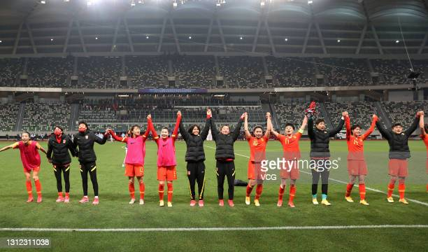 Players of China celebrate victory after the Tokyo Olympics Women's Football Asian Final Qualifier 2nd leg match between China and South Korea at the...