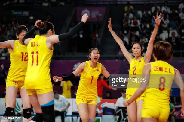 Players of China celebrate victory during the Asian Games 2018 Volleyball Women's Semifinals between China and Japan on day thirteen of the Asian...