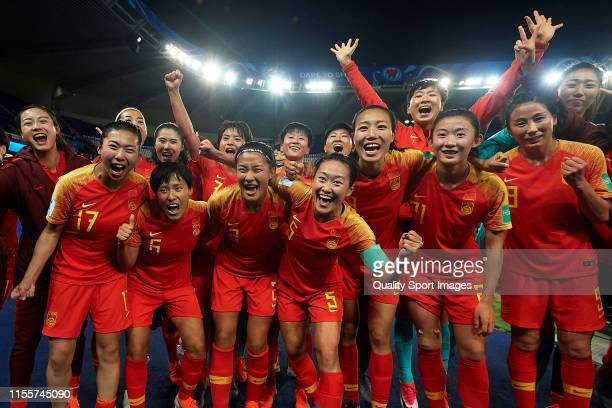 Players of China PR celebrate after winning the 2019 FIFA Women's World Cup France group B match between South Africa and China PR at Parc des...