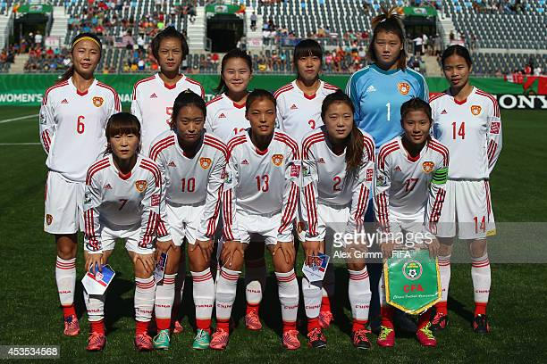 Players of China PR pose for a team photo prior to the FIFA U20 Women's World Cup Canada 2014 group B match between the United States and China PR at...