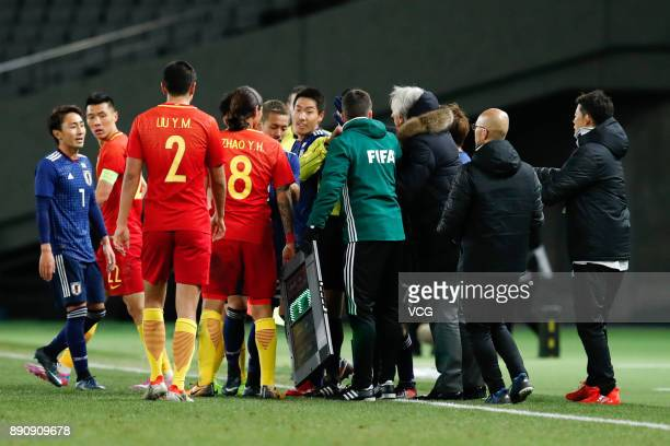 Players of China quarrel with players of Japan during the EAFF E1 Men's Football Championship between Japan and China at Ajinomoto Stadium on...