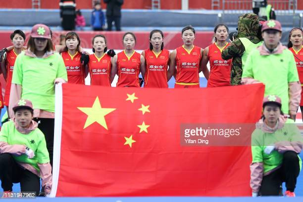 Players of China sing the national anthem prior to the Women's FIH Field Hockey Pro League match between China and New Zealand at on March 22 2019 in...