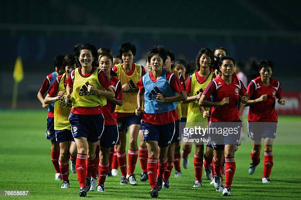 Players of China warm up during a training session for the FIFA 2007 World Cup in China at Wuhan Sports Center Stadium on September 11, 2007 in...