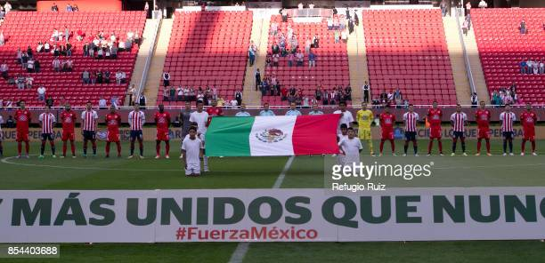 Players of Chivas and Lobos pose behind a Mexican flag and show support to Mexican society after the earthquake that struck Mexico City, Puebla and...
