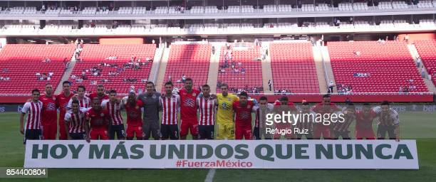 Players of Chivas and Lobos pose showing support to Mexican society after the earthquake that struck Mexico City, Puebla and Morelos prior the 11th...