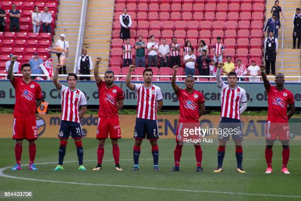 Players of Chivas and Lobos rise their fist to show support after the earthquake that struck Mexico City, Puebla and Morelos prior the 11th round...