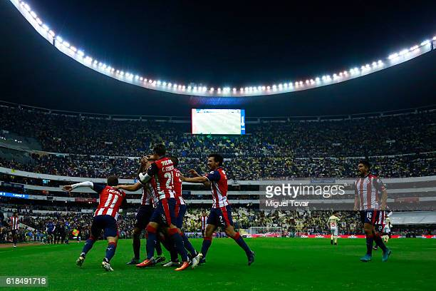 Players of Chivas celebrate after winning the semifinal match between America and Chivas as part of the Copa MX Apertura 2016 at Azteca Stadium on...