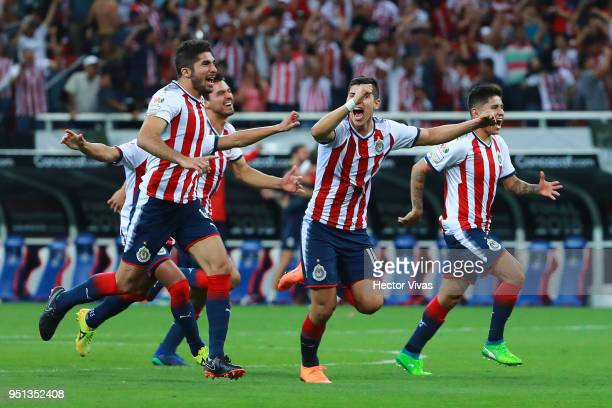 Players of Chivas celebrate their victory during the second leg match of the final between Chivas and Toronto FC as part of CONCACAF Champions League...