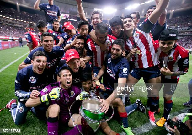 Players of Chivas celebrate with the trophy after winning the final match between Chivas and Morelia as part of the Copa MX Clausura 2017 at Chivas...