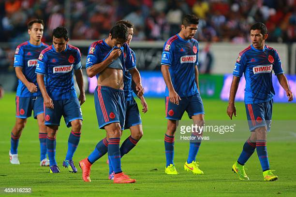 Players of Chivas leave the field after a defeating during a match between Pachuca and Chivas as part of 4th round Apertura 2014 Liga MX at Hidalgo...