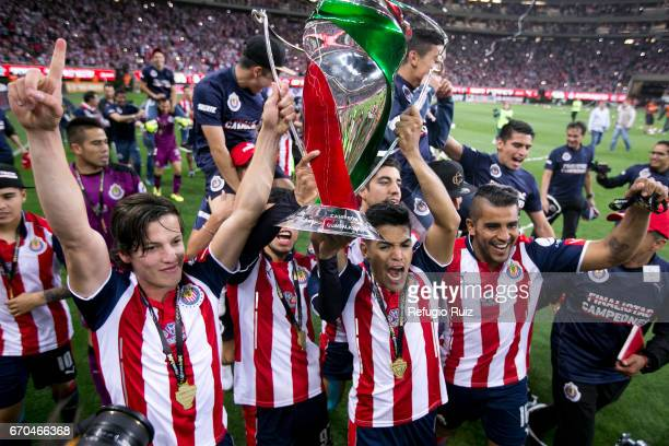 Players of Chivas lift the trophy to celebrate after winning the final match between Chivas and Morelia as part of the Copa MX Clausura 2017 at...