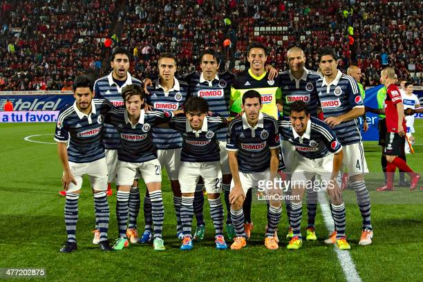 Players of Chivas pose for a photo before a match between Tijuana and Chivas as part of the 10th round Clausura 2014 Liga MX at Caliente Stadium on...