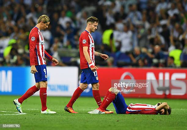 Players of Club Atletico de Madrid show their dejection during the UEFA Champions League Final match between Real Madrid and Club Atletico de Madrid...
