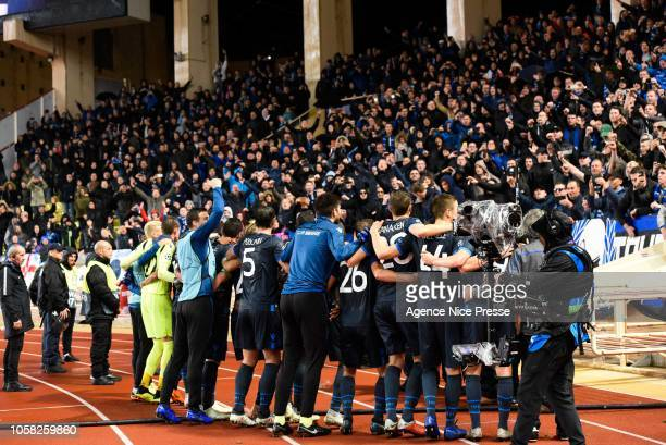 Players of Club Brugge celebrates the victory with fans during the UEFA Champions League Group A match between AS Monaco and Club Brugge at Stade...
