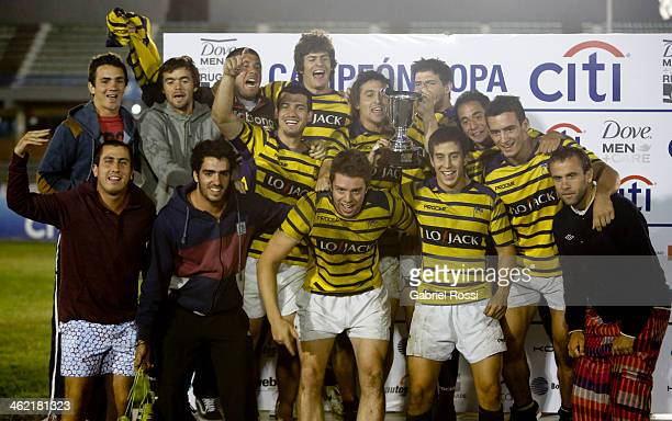 Players of Club Regatas pose for a photo after winning the clubs gold cup final match between Club Regatas and San Isidro Club as part of Dove Men's...