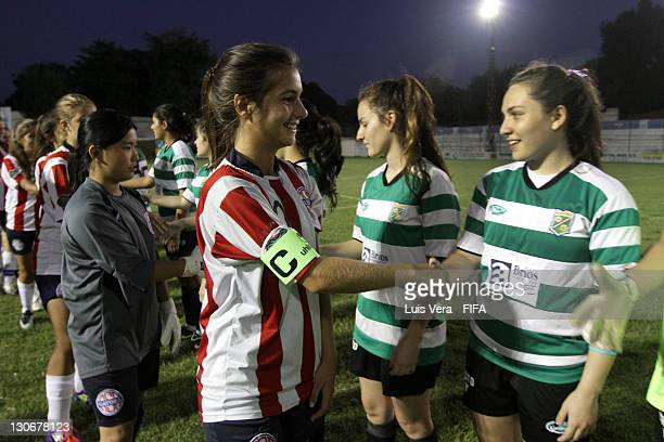 Players of Colegio Cristo Rey and American School shake hands before the FIFA Women's Football Initiative on October 27 2011 in Asuncion Paraguay