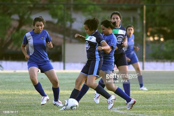 Players of Colegio Tecnico de Luqe and Colegio San Jose in action during the FIFA Women's Football Initiative on October 27 2011 in Asuncion Paraguay