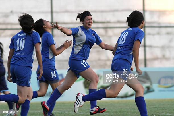 Players of colegio Tecnico de Luqe celebrate scoring a goal during the FIFA Women's Football Initiative on October 27 2011 in Asuncion Paraguay