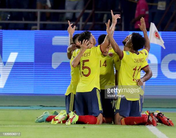 Players of Colombia celebrate after Mieguel Borja scored the first goal of their team during a match between Colombia and Chile as part of South...