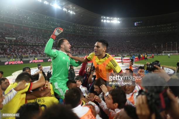 Players of Colombia celebrate after the 2018 FIFA World Cup Qualification match between Peru and Colombia at National Stadium in Lima Peru on October...