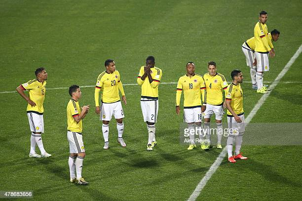 Players of Colombia look dejected after the 2015 Copa America Chile quarter final match between Argentina and Colombia at Sausalito Stadium on June...