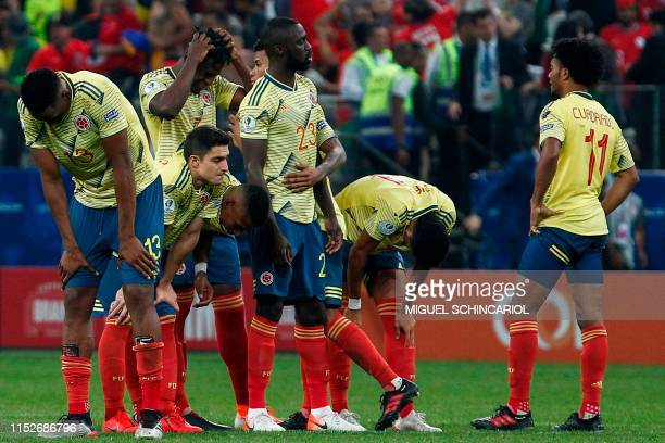 Players of Colombia show their dejection after Chile's Alexis Sanchez scored his penalty in the penalty shootout to defeat them after tying 00 during...