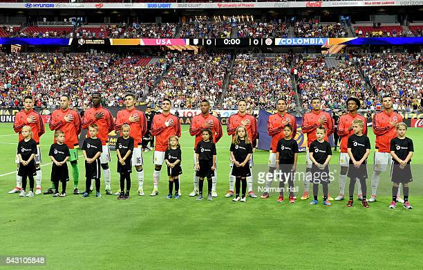 Players of Colombia sing their national anthem prior to a third place match between United States and Colombia at University of Phoenix Stadium as...