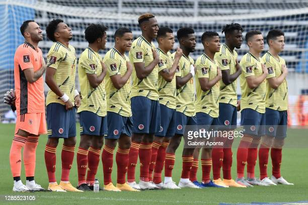 Players of Colombia stand during the national anthem before a match between Colombia and Uruguay as part of South American Qualifiers for Qatar 2022...
