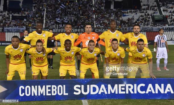 Players of Colombia's Independiente Santa Fe pose for pictures before the start of their Copa Sudamericana football match against Paraguay's Libertad...